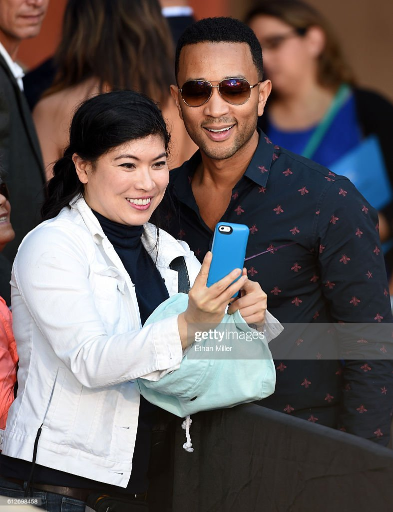A supporter takes a selfie with singer/songwriter John Legend (R) after his wife, model and television personality Chrissy Teigen (not pictured), spoke at a campaign event with U.S. Sen. Elizabeth Warren (D-MA) at The Springs Preserve on October 4, 2016 in Las Vegas, Nevada. Warren and Teigen are campaigning for Democratic presidential nominee Hillary Clinton and former Nevada Attorney General and U.S. Senate candidate Catherine Cortez Masto.