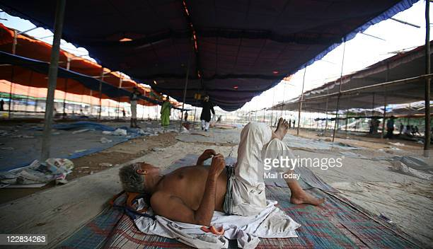 Supporter takes nap after Anna Hazare left Ramlila Maidan on Sunday. Hazare ended his fast on the 13th day amidst thousands of supporters after...