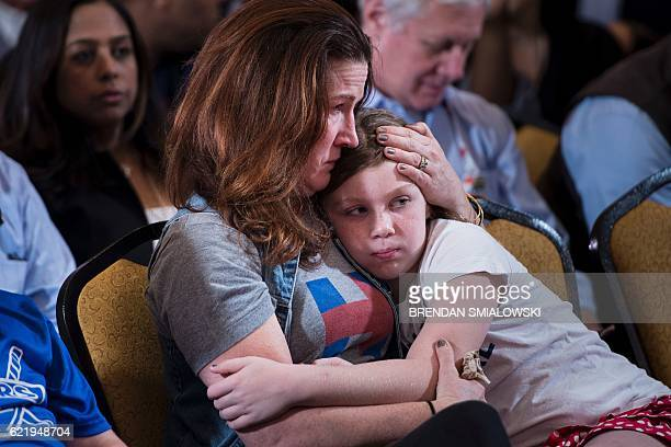 A supporter waits for former Democratic US Presidential candidate Hillary Clinton to speak at the New Yorker Hotel after her defeat to rival...