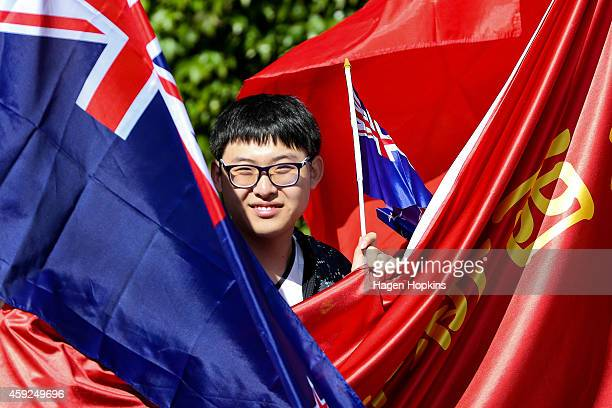 A supporter waits for the arrival of President Xi Jinping Of China at Government House on November 20 2014 in Wellington New Zealand President Xi...