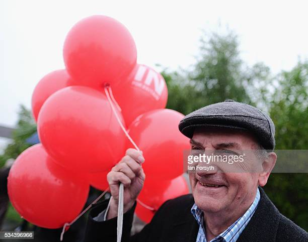 A supporter waits with balloons for Shadow Foreign Secretary Hilary Benn MP as he visits the Angel of the North with the Labour In for Britain battle...