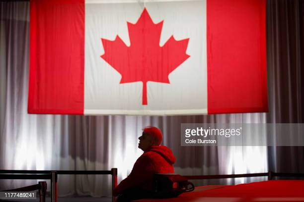 A supporter watches early election results roll in at Canadian Prime Minister Justin Trudeau's election night headquarters on October 21 2019 in...