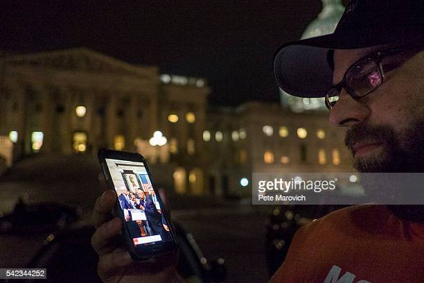 A supporter watches the proceedings being streamed live from the House floor by Democrats taking part in a sitin on the House Chamber outside the US...