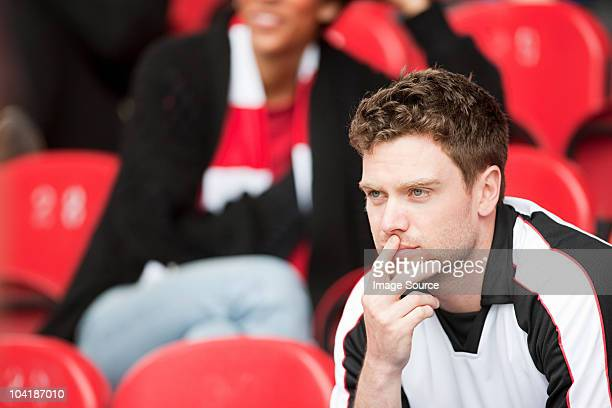 supporter watching football match - spectator stock pictures, royalty-free photos & images