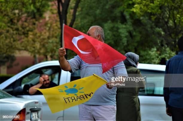 A supporter waves a party flag and a Turkish flag during a rally in support of Meral Aksener presidential candidate and the leader of the opposition...