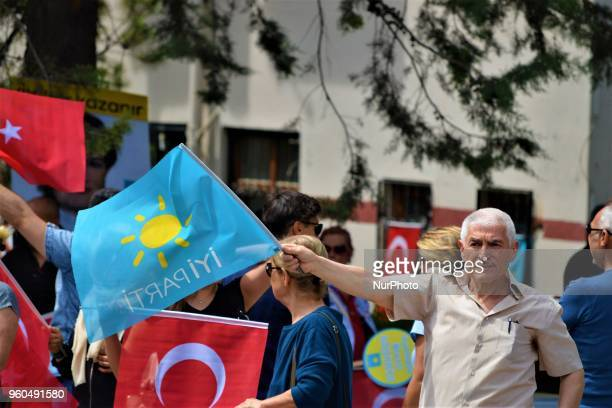 A supporter waves a party flag during a rally in support of Meral Aksener presidential candidate and the leader of the opposition IYI Party in Ankara...