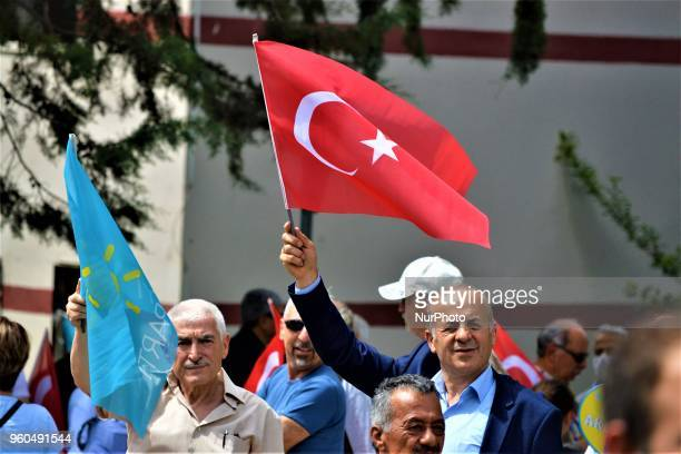 A supporter waves a Turkish flag during a rally in support of Meral Aksener presidential candidate and the leader of the opposition IYI Party in...