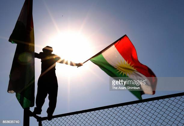 Supporter waves the Kurdish flag during a rally for the upcoming referendum for independence of Kurdistan on September 22, 2017 in Erbil, Iraq. The...