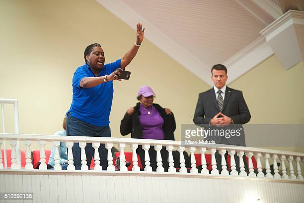 A supporter waves to Democratic Presidential candidate former Secretary of State Hillary Clinton at a Breaking Down Barriers Town Hall with Senator...