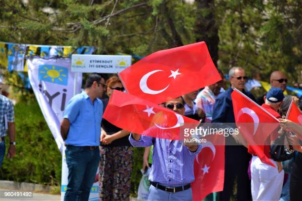 A supporter waves Turkish flags during a rally in support of Meral Aksener presidential candidate and the leader of the opposition IYI Party in...