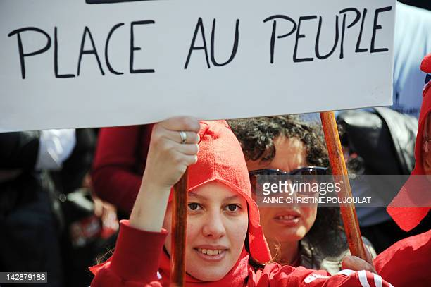A supporter wearing a French revolutionary Phrygian cap of French Front de Gauche leftist party's candidate for the 2012 French presidential election...