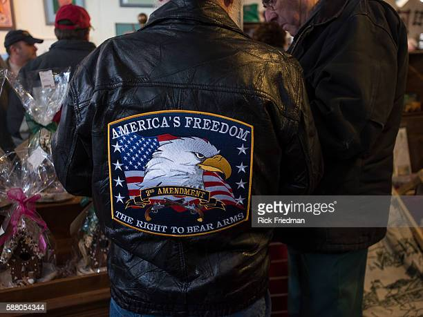A supporter wearing a jacket supporting 2nd Amendment rights waiting for Republican Presidential candidate Senator Ted Cruz at a campaign stop at at...