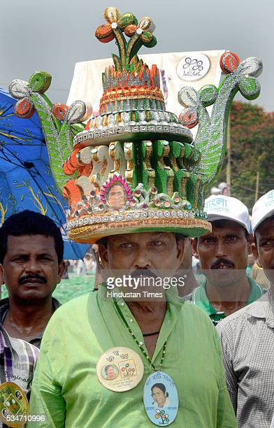 TMC supporter wearing designed hat symbolising victory of West Bengal Chief Minister Mamata Banerjee during her oath taking ceremony on May 27 2016...