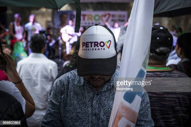 A supporter wears a campaign cap as Gustavo Petro presidential candidate for the Progressivists Movement Party holds a rally in Pereira Colombia on...