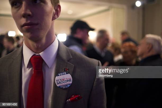 A supporter wears a campaign pin at an election night rally with Rick Saccone Republican candidate for the US House of Representatives not pictured...