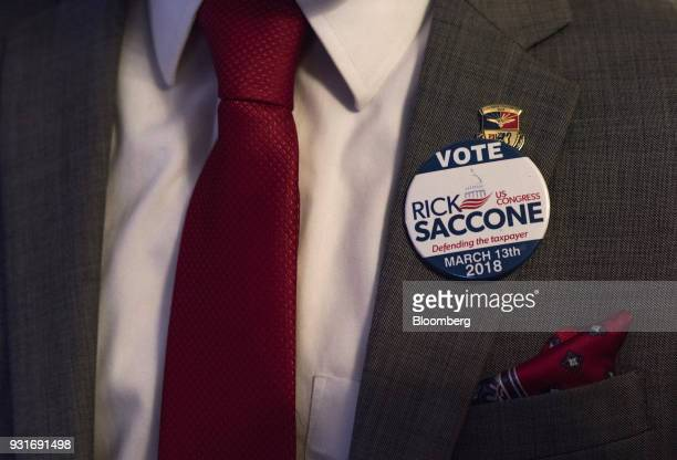 A supporter wears a campaign pin during an election night rally with Rick Saccone Republican candidate for the US House of Representatives not...