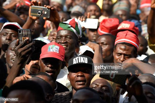 A supporter wears a cap reading Atiku the name of presidential candidate of the Nigeria's opposition party Peoples Democratic Party Atiku Abubakar...