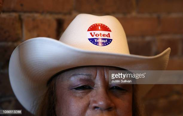 A supporter wears a cowboy hat with an I Voted sticker affixed to it as US Sen Ted Cruz speaks during a Get Out The Vote Bus Tour rally on November 2...