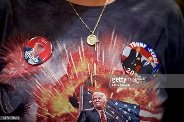 A supporter wears a Donald J Trump themed shirt and campaign pins before the Republican Presidential nominee holds an event at the Eisenhower Hotel...