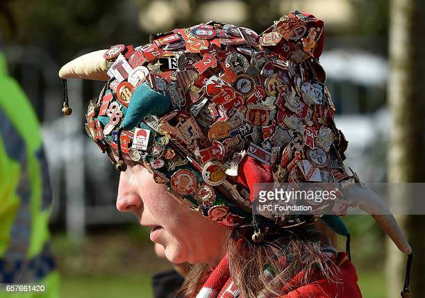 A supporter wears a hat covered in Liverpool badges during the match between Liverpool Legends and Real Madrid Legends at Anfield on March 25 in...