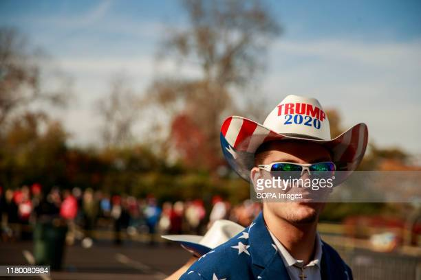 """Supporter wears a hat saying """"Trump 2020"""" during a Keep America Great rally at the Rupp Arena in Lexington."""