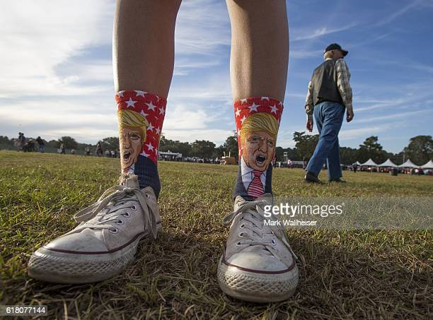 A supporter wears a pair of Trump socks to a Republican presidential candidate Donald Trump rally at the Antique Car Museum property on October 25...