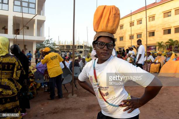 Supporter wears a t-shirt with the electoral poster of her leader during a rally, in Banjul on April 4, 2017. The Gambia holds its first election on...