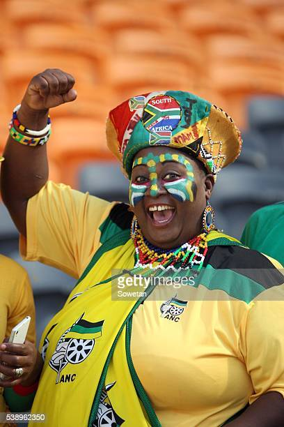 A supporter wears ANC regalia during the partys Gauteng manifesto launch at FNB Stadium on June 04 2016 in Johannesburg South Africa Speaking at the...