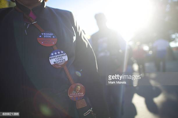 A supporter wears campaign pins outside before a rally for Republican Presidential nominee Donald J Trump November 4 2016 at Giant Center in Hershey...