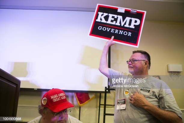 Supporter William Thompson shows his support for Secretary of State and Republican Gubernatorial candidate Brian Kemp during an election watch party...