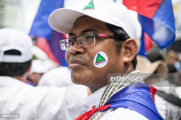 GDP supporter with a party cap and sticker Grassroots Democratic Party is running for the July 2018 elections with Yang Saing Koma as candidate They...