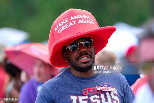 Supporter with a pro Trump hat awaits President Trump during the MAGA rally in Fayetteville.
