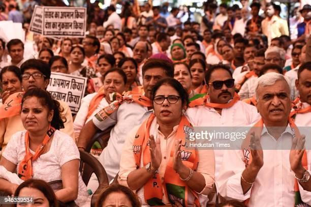 BJP supporters along with the ministers during a daylong hunger strike to protest against the disruption of Parliament by the opposition at Hanuman...