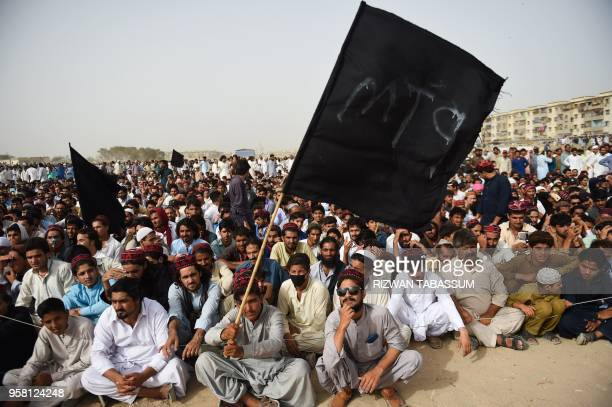 Supporters and activists of Pashtun Protection Movement wait for their leader Manzoor Pastheen during a protest rally in Karachi on May 132018 The...