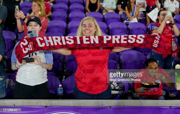 USA supporters and Christen Press of the United States during a game between England and USWNT at Exploria Stadium on March 05 2020 in Orlando Florida