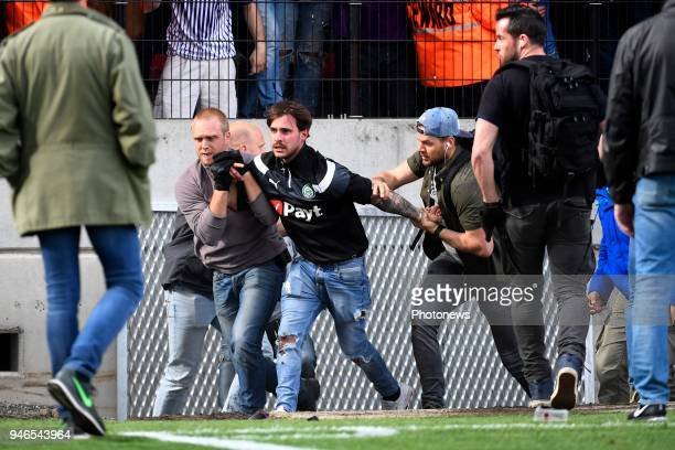 Supporters and Fans against policemen during the Jupiler Pro League play off 2 match between Royal Antwerp FC and Beerschot Wilrijk on April 15 2018...