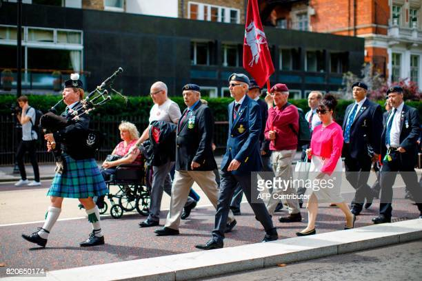 Supporters and former soldiers march from Hyde Park Barracks to demand justice for those who died in a 1982 IRA bomb attack in London on July 22 2017...