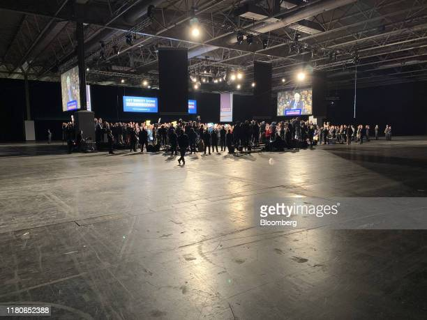 Supporters and members of the media listen as Boris Johnson UK prime minister and leader of Conservative Party speaks during the official launch of...