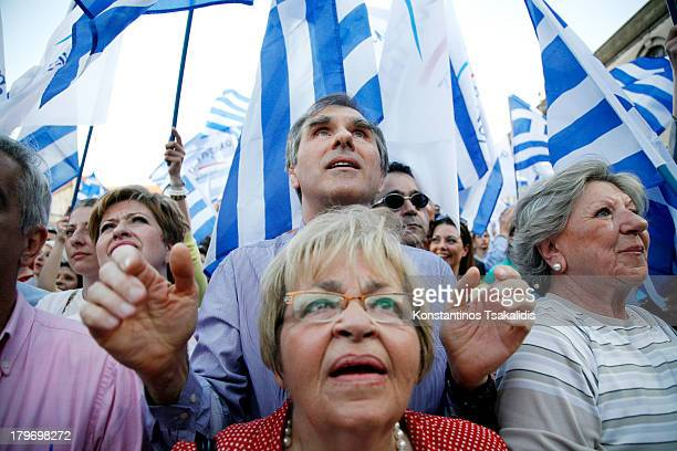 Supporters and party members looks at Panos Kammenos, as leader of the Independent Greeks gives pre-election speech in Thessaloniki. May 2, 2012.