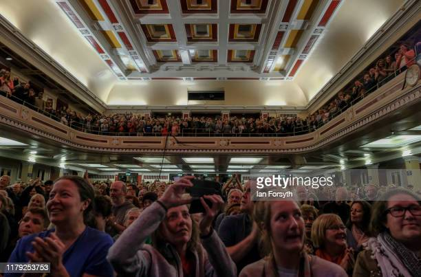 Supporters and party members react as they listen to speeches during a Labour Party campaign rally at Newcastle City Hall on October 05 2019 in...