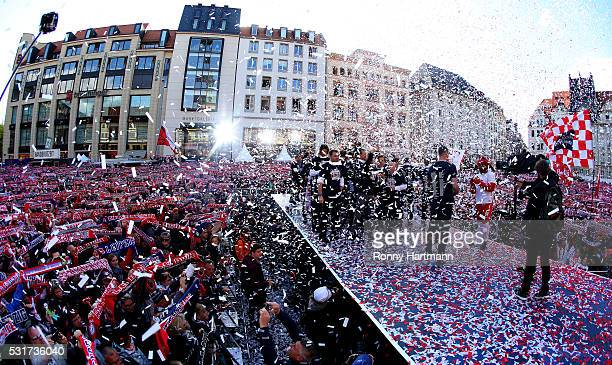 Supporters and Players of RB Leipzig celebrate promotion to the Bundesliga on May 16 2016 in Leipzig Germany
