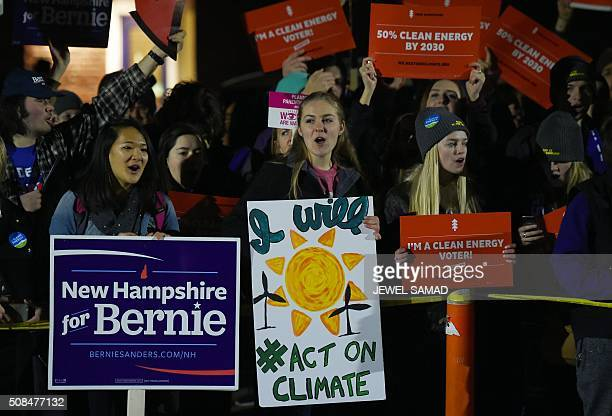 Supporters and protesters gather outside as US Democratic presidential candidates Hillary Clinton and Bernie Sanders participate in the MSNBC...
