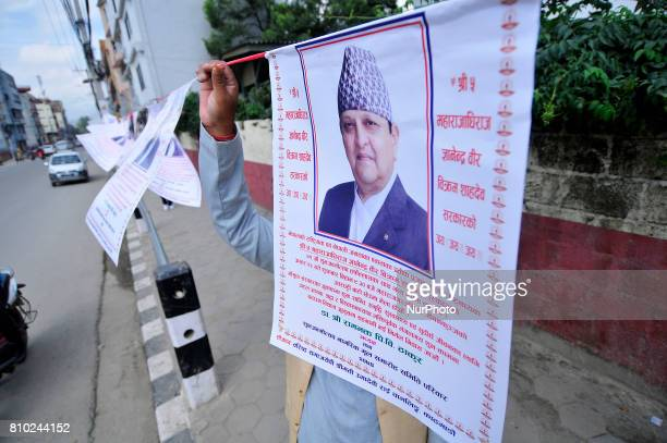Supporters and well-wisher arranging posters of Former King Gyanendra Shah during on his 71th birthday at his residence Nirmal Niwas, Maharjagunj,...