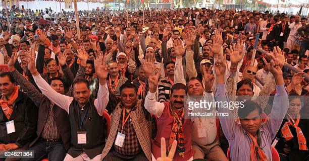 Supporters and workers during party workers 'sammelan' rally of BJP President Amit Shah at Ramleela Maidan in Sector 27 on November 20 2016 in...