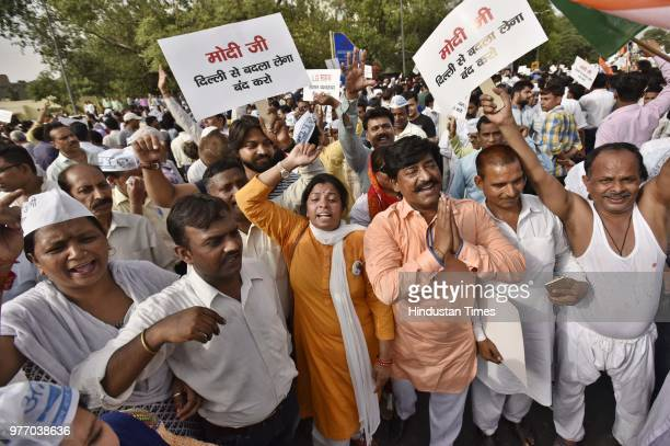 AAP supporters and workers march from Mandi House to Prime Minister's residence in support of Delhi Chief Minister Arvind Kejriwal's sitin protest at...