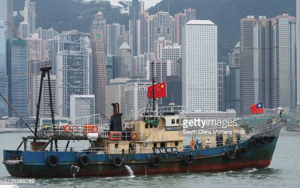 Supporters applaud as Hong Kong fishing vessel Kai Fung No 2 which went to the disputed Diaoyu islands docks at a public pier at Hong Kong's Victoria...