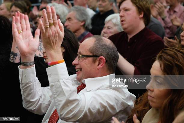 Supporters applaud as Labour leader Jeremy Corbyn addresses party supporters at the River Tees Watersports Centre during a visit to rally local...