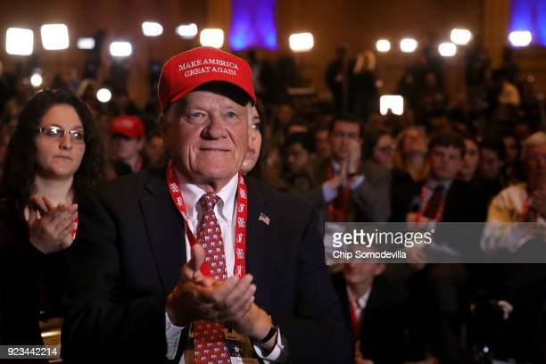 Supporters applaud as US President Donald Trump addresses the Conservative Political Action Conference at the Gaylord National Resort and Convention...
