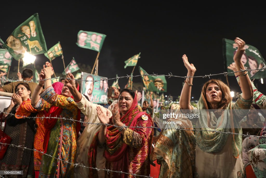 Supporters applaud during a campaign rally for Pakistan Muslim LeagueNawaz in Rawalpindi Pakistan on Monday July 23 2018 Whoever wins Pakistan`s...