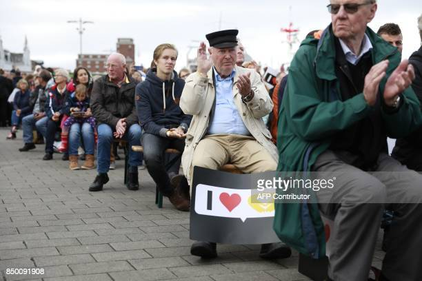 Supporters applaud German Chancellor Angela Merkel during an election campaign rally of the Christian Democratic Union in Kappeln northern Germany on...